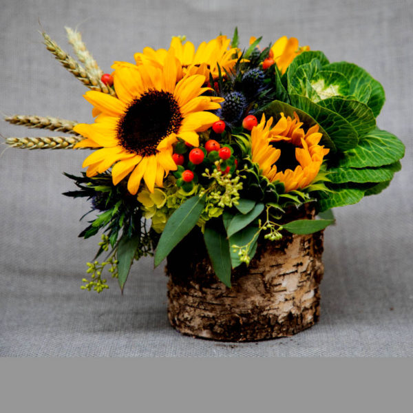 Sunflower arrangement reminiscent of a walk through the woods.