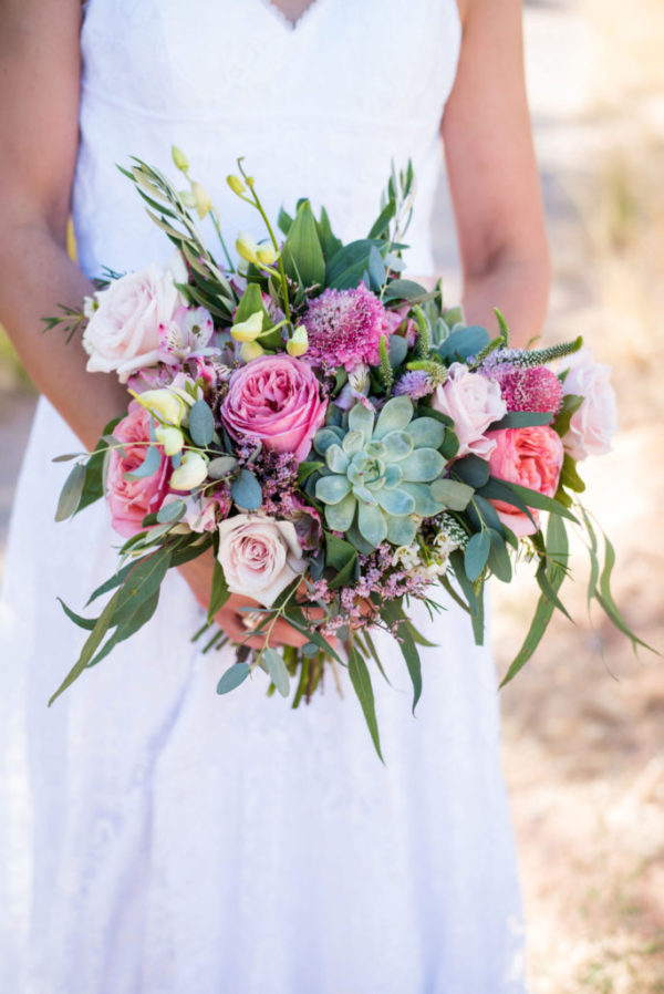 Custom wedding bouquet with pink flowers and succulents.
