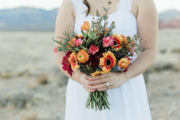 Custom wedding bouquet with orange and pink flowers