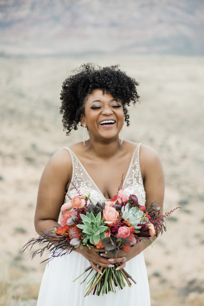 Bride with bouquet of eco-friendly flowers and succulents